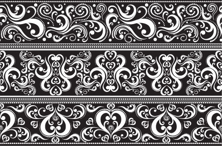 Image of 'Decorative white lace with pattern on black background'